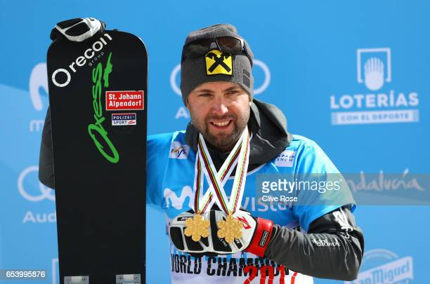 Gold medalist Andreas Prommegger of Austria celebrates during the medal ceremony for the Men's Parallel Giant Slalom on day 9 of the FIS Freestyle...