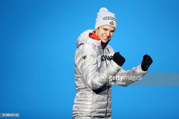 Gold medalist Andreas Wellinger of Germany celebrates during the Medal Ceremony for the Men's Ski Jumping Normal Hill Individual on day two of the...