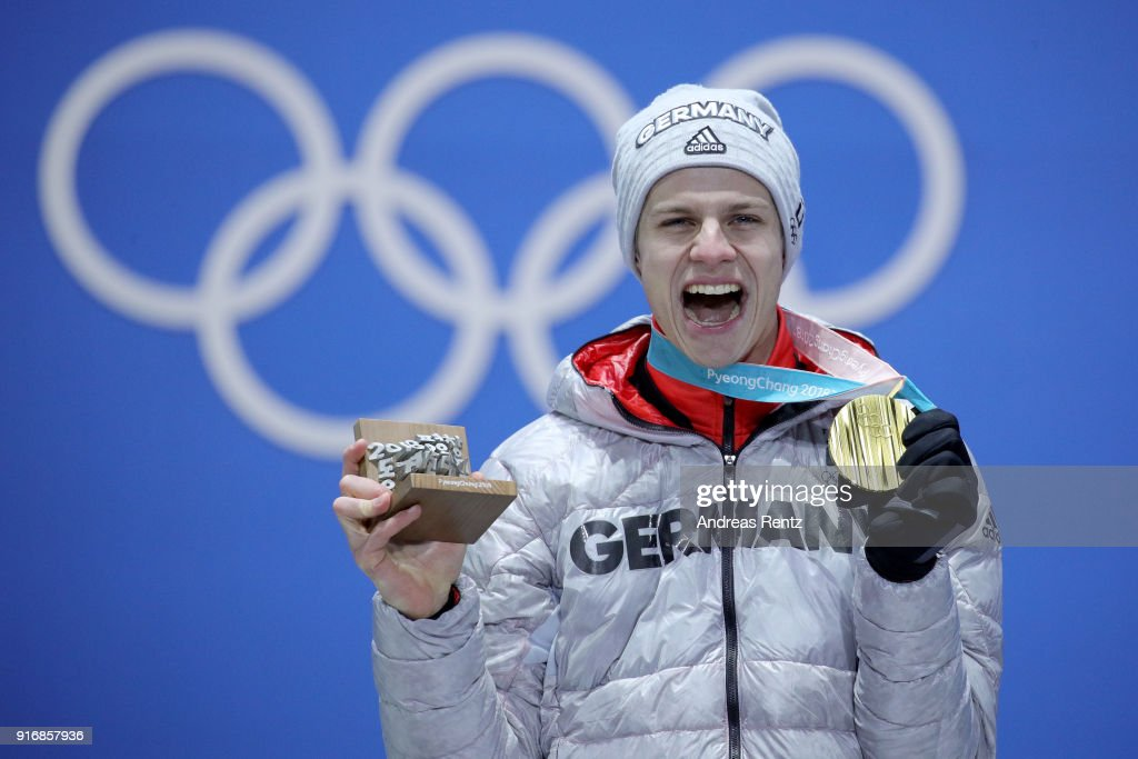 Gold medalist Andreas Wellinger of Germany celebrates on the podium during the Medal Ceremony for the Men's Ski Jumping Normal Hill Individual on day two of the PyeongChang 2018 Winter Olympic Games at Medal Plaza on February 11, 2018 in Pyeongchang-gun, South Korea.