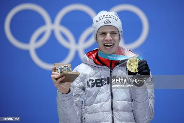 Gold medalist Andreas Wellinger of Germany celebrates on the podium during the Medal Ceremony for the Men's Ski Jumping Normal Hill Individual on day...