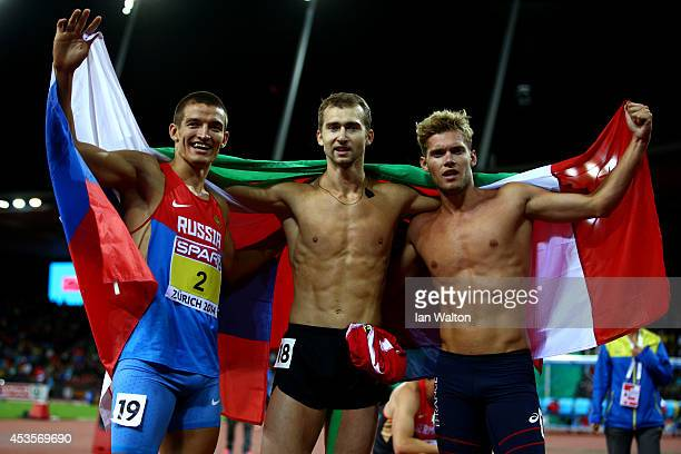 Gold medalist Andrei Krauchanka of Belarus, silver medalist Kevin Mayer of France and bronze medalist Ilya Shkurenyov of Russia celebrate after the...