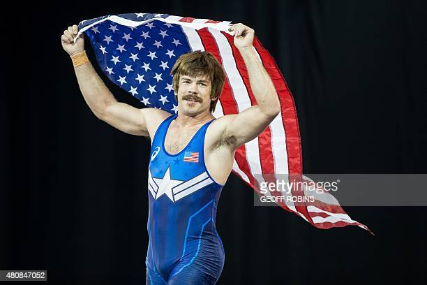 Gold medalist Andrew Bisek of the United States celebrates his win over Alvis Almendra of Panama in the 85kg class of the men's GrecoRoman wrestling...