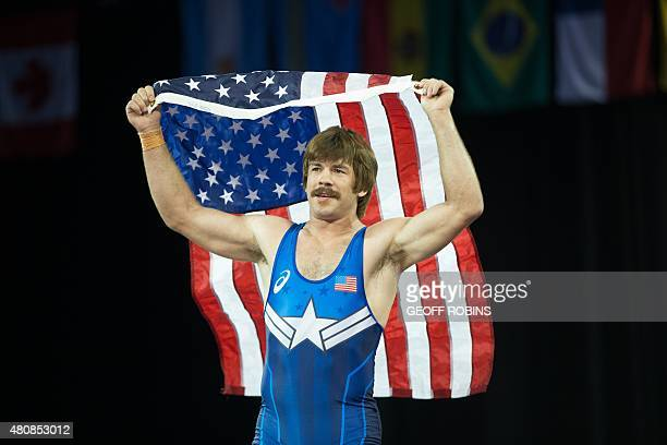 Gold medalist Andrew Bisek of the United States celebrates his win over Alvis Almendra of Panama in the 75kg class of the men's grecoroman wrestling...