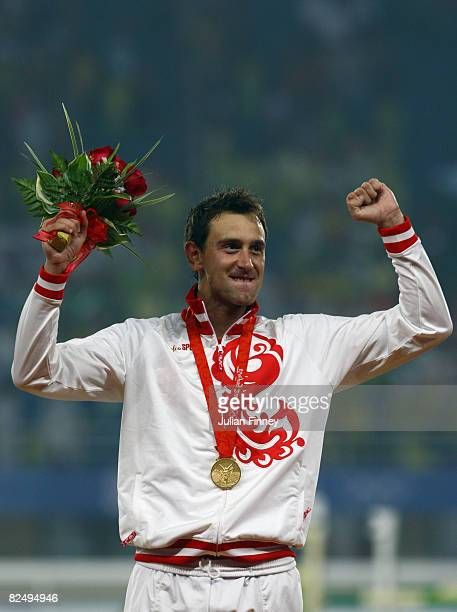 Gold medalist Andrey Moiseev of Russia celebrates on the podium during the medal ceremony for the Men's Modern Pentathlon held at the OSC Stadium...