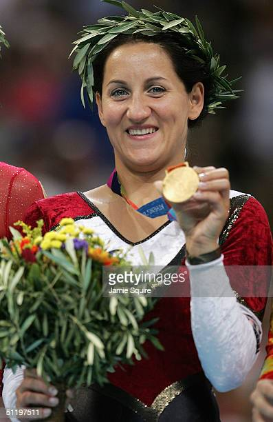 Gold medalist Anna Dogonadze of Germany poses with her medal after the women's trampoline final on August 20 2004 during the Athens 2004 Summer...