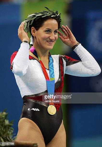 Gold medalist Anna Dogonadze of Germany receives her gold medal after the women's trampoline final on August 20 2004 during the Athens 2004 Summer...