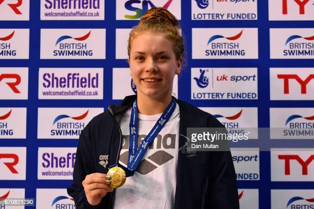 Gold medalist Anna Hopkin of Ealing poses with the medal won in the Womens Open 50m Freestyle final on day three of the British Swimming...