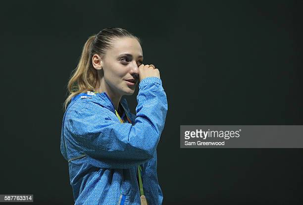 Gold medalist Anna Korakaki cries on the podium during the medal ceremony for the Women's 25m pistol event on Day 4 of the Rio 2016 Olympic Games at...