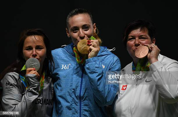 Gold medalist Anna Korakaki of Greece silver medalist Monika Karsch of Germany and bronze medalist Heidi Diethelm Gerber of Switzerland kiss their...