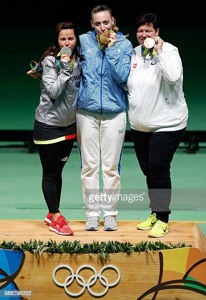 Gold medalist Anna Korakaki of Greece silver medalist Monika Karsch of Germany and bronze medalist Heidi Diethelm Gerber of Switzerland show their...