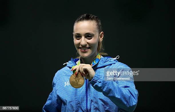 Gold medalist Anna Korakaki of Greece smiles on the podium during the medal ceremony for the Women's 25m pistol event on Day 4 of the Rio 2016...
