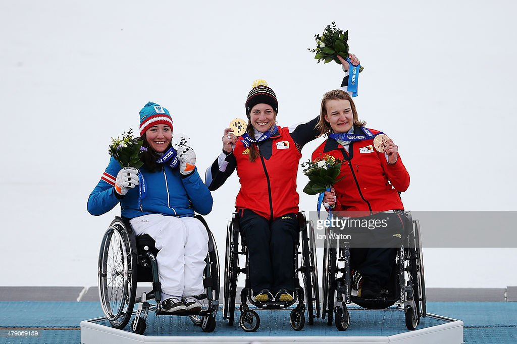 Gold medalist Anna Schaffelhuber (C) of Germany, silver medalist Claudia Loesch (L) of Austria and bronze medalist Anna-Lena Forster of Germany celebrate during the medal ceremony for the Women's Giant Slalom Sitting during day nine of the Sochi 2014 Paralympic Winter Games at Rosa Khutor Alpine Center on March 16, 2014 in Sochi, Russia.