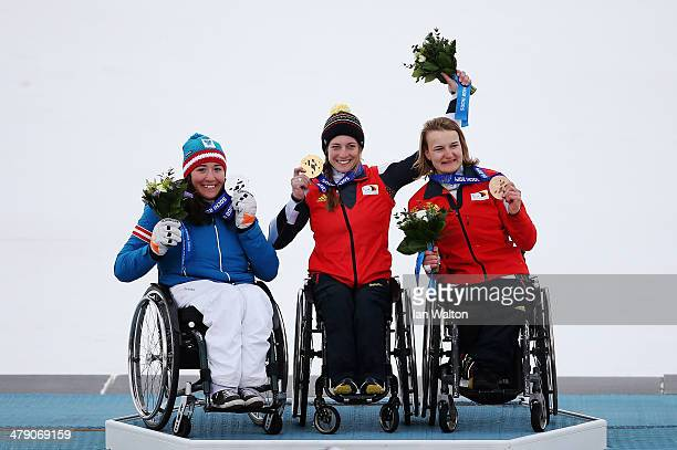 Gold medalist Anna Schaffelhuber of Germany silver medalist Claudia Loesch of Austria and bronze medalist AnnaLena Forster of Germany celebrate...