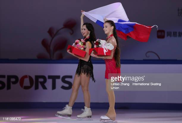 Gold medalist Anna Shcherbakova of Russia and bronze medalist Elizaveta Tuktamysheva of Russia celebrate during the victory ceremony of the Ladies...