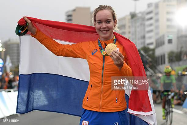 Gold medalist Anna van der Breggen of the Netherlands celebrates on the podium following the Women's Road Race on Day 2 of the Rio 2016 Olympic Games...