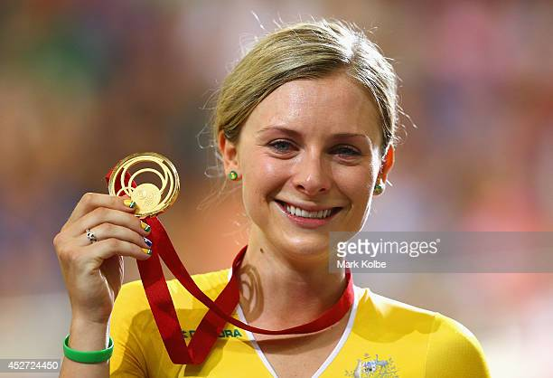 Gold medalist Annette Edmondson of Australia celebrates on the podium during the medal ceremony for the Women's 10km Scratch finals at Sir Chris Hoy...