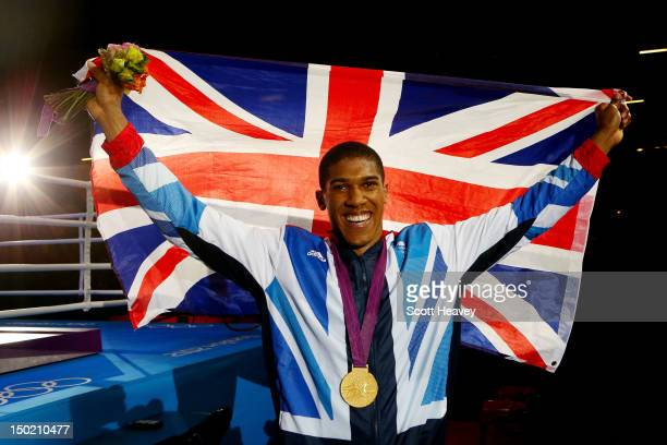 Gold medalist Anthony Joshua of Great Britain celebrates after the medal ceremony for the Men's Super Heavy Boxing final bout on Day 16 of the London...
