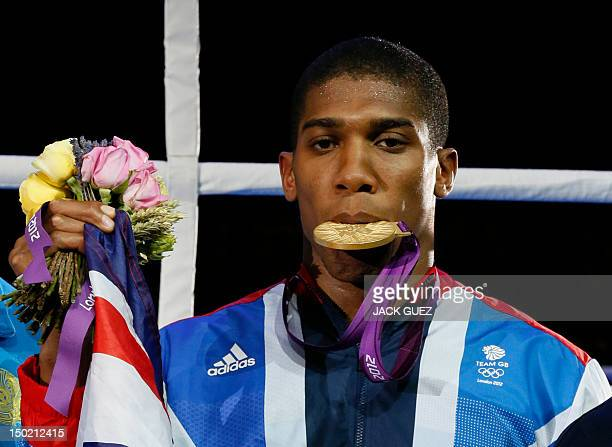 Gold medalist Anthony Joshua of Great Britain celebrates during the awards ceremony for the Super-Heavyweight boxing category of the 2012 London...