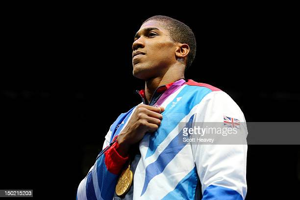 Gold medalist Anthony Joshua of Great Britain celebrates on the podium during the medal ceremony for the Men's Super Heavy Boxing final bout on Day...