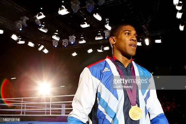 Gold medalist Anthony Joshua of Great Britain walks away from the ring after the medal ceremony for the Men's Super Heavy Boxing final bout on Day 16...