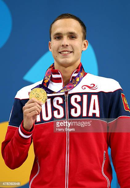 Gold medalist Anton Chupkov of Russia poses on the podium during the medal ceremony for the Men's 200m Breaststroke final during day twelve of the...