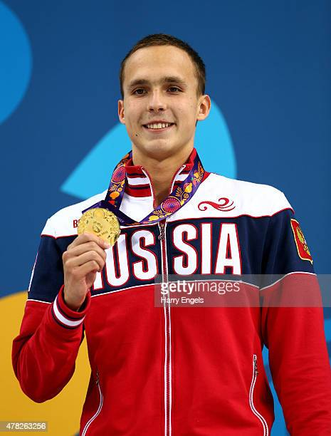 Gold medalist Anton Chupkov of Russia stands on the podium during the medal ceremony for the Men's 200m Breaststroke final during day twelve of the...
