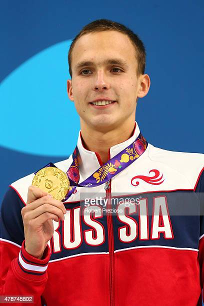 Gold medalist Anton Chupkov of Russia stands on the podium during the medal ceremony for the Men's 100m Breaststroke during day fifteen of the Baku...