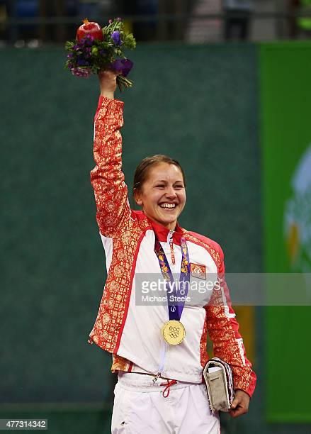 Gold medalist Anzhela Dorogan of Azerbaijan celebrates during the medal ceremony for the Women's Wrestling 53kg Freestyle during day four of the Baku...