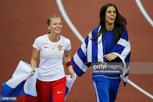 Gold medalist Anzhelika Sidorova of Russia and silver medalist Ekaterini Stefanidi of Greece celebrate after the Women's Pole Vault final during day...