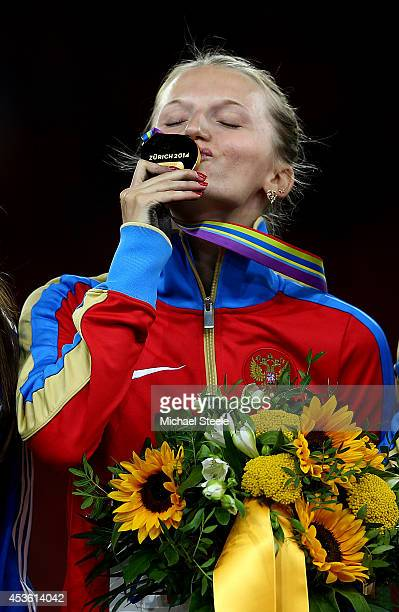 Gold medalist Anzhelika Sidorova of Russia kisses her medal during the medal ceremony for the Women's Pole Vault final during day three of the 22nd...