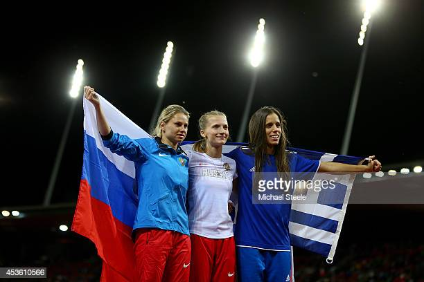 Gold medalist Anzhelika Sidorova of Russia silver medalist Ekaterini Stefanidi of Greece and bronze medalist Angelina ZhukKrasnova of Russia pose...