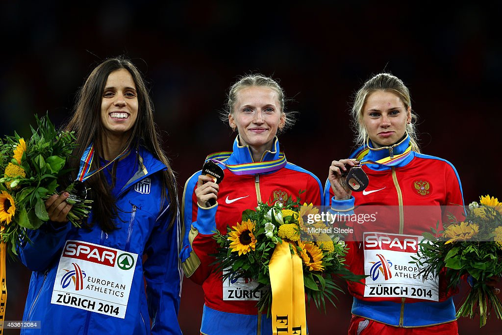 Gold medalist Anzhelika Sidorova (C) of Russia, silver medalist Ekaterini Stefanidi (L) of Greece and bronze medalist Angelina Zhuk-Krasnova of Russia pose with their medals on the podium during the medal ceremony for the Women's Pole Vault final during day three of the 22nd European Athletics Championships at Stadium Letzigrund on August 14, 2014 in Zurich, Switzerland.
