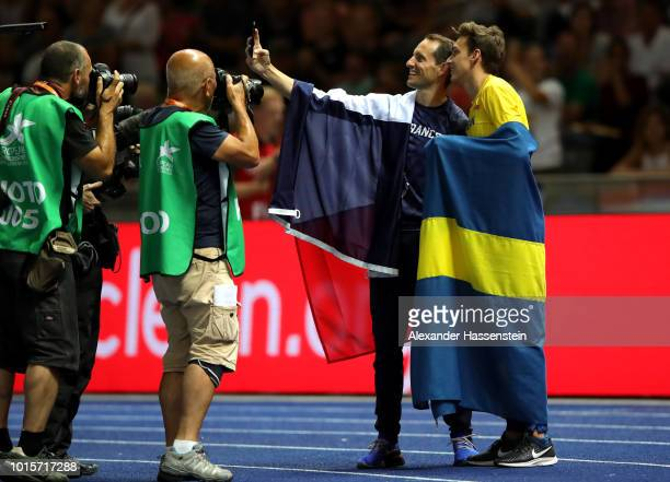 Gold medalist Armand Duplantis of Sweden and Bronze medalist Renaud Lavillenie of France celebrate after the Men's Pole Vault final during day six of...