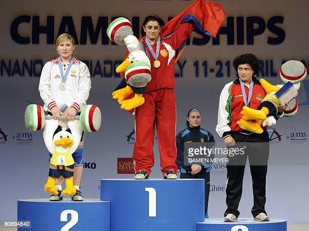Gold medalist Armenia's Nazik Avdalyan flanked by silver medalist Russia's Tatiana Matveeva and bronze medalist Bulgarian Slaveyka Ruzhinska waves...