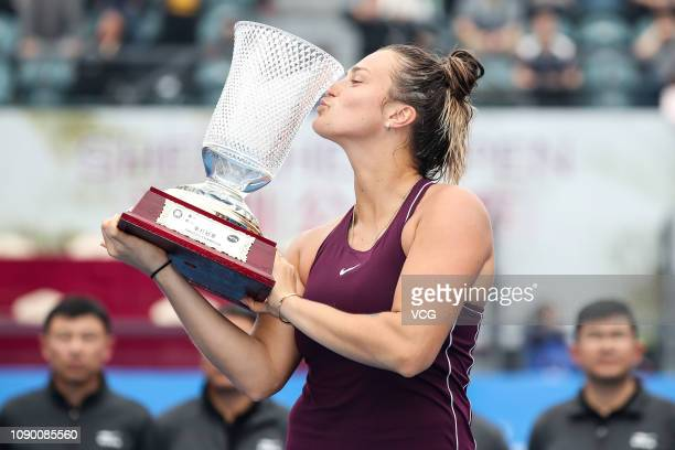 Gold medalist Aryna Sabalenka of Belarus kisses trophy after winning the women's singles final match against Alison Riske of United States on main...