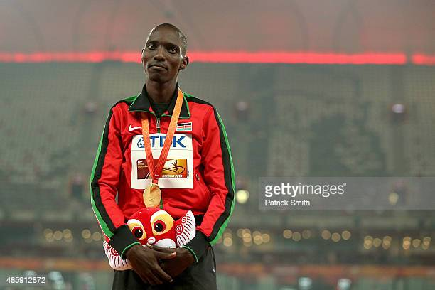 Gold medalist Asbel Kiprop of Kenya poses on the podium during the medal ceremony for the Men's 1500 metres final during day nine of the 15th IAAF...