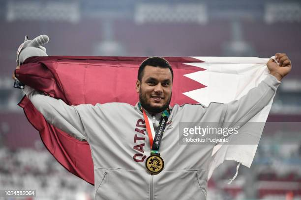 Gold medalist Ashraf Elseify of Qatar celebrates on the podium during Men's Hammer Throw victory ceremony on day nine of the Asian Games on August 27...