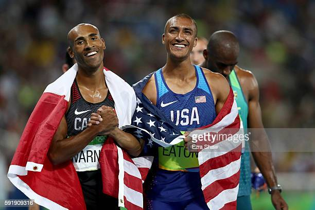 Gold medalist Ashton Eaton of the United States celebrates with silver medalist Damian Warner of Canada after the Men's Decathlon 1500m on Day 13 of...