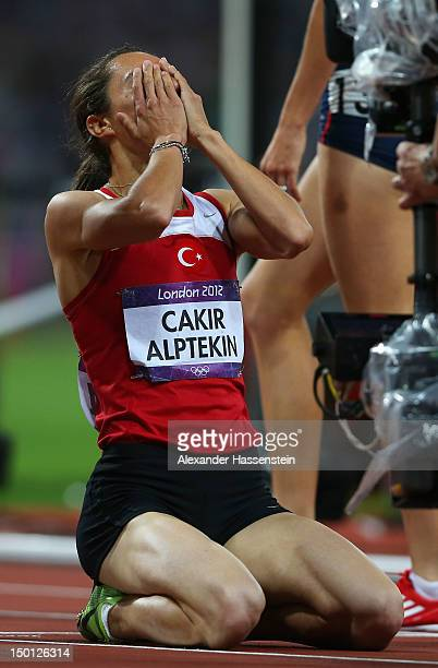 Gold medalist Asli Cakir Alptekin of Turkey celebrates after the Women's 1500m Final on Day 14 of the London 2012 Olympic Games at Olympic Stadium on...