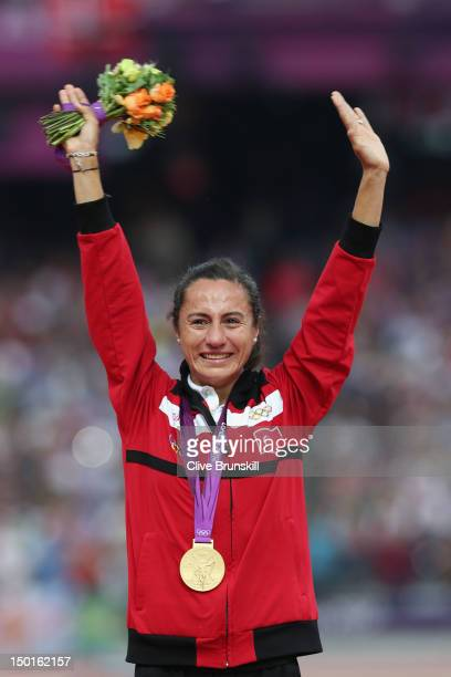 Gold medalist Asli Cakir Alptekin of Turkey poses on the podium during the medal ceremony for the Women's 1500m on Day 15 of the London 2012 Olympic...