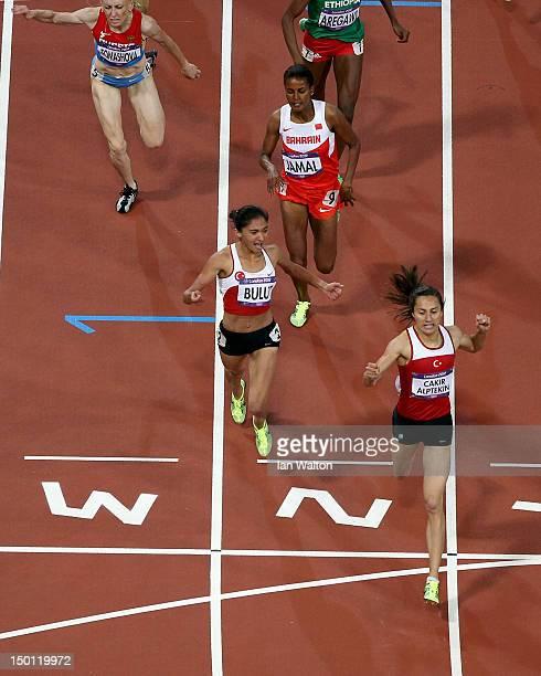 Gold medalist Asli Cakir Alptekin of Turkey silver medalist Gamze Bulut of Turkey and bronze medalist Maryam Yusuf Jamal of Bahrain cross the finish...