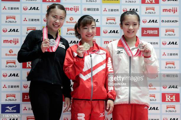 Gold medalist Asuka Teramoto celebrates with silver medalist Aiko Sugihara and bronze medalist Kiko Kuwajima at the award ceremony for the Women's...