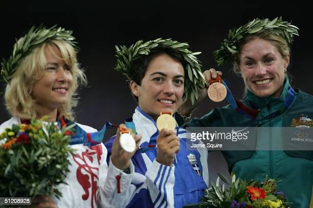 Gold medalist Athanasia Tsoumelka of Greece silver medalist Olimpiada Ivanova of Russia and bronze medalist Jane Saville of Australia celebrate on...