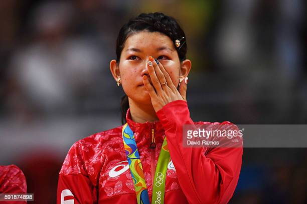 Gold medalist Ayaka Takahashi of Japan show her emotion on the podium during the medal ceremony for the Women's Doubles Badminton on Day 13 of the...