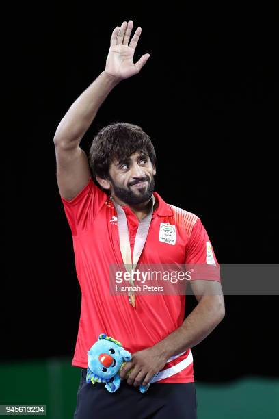 Gold medalist Bajrang of India poses during the medal ceremony for the Men's Freestyle 65 kg Gold Medal on day nine of the Gold Coast 2018...