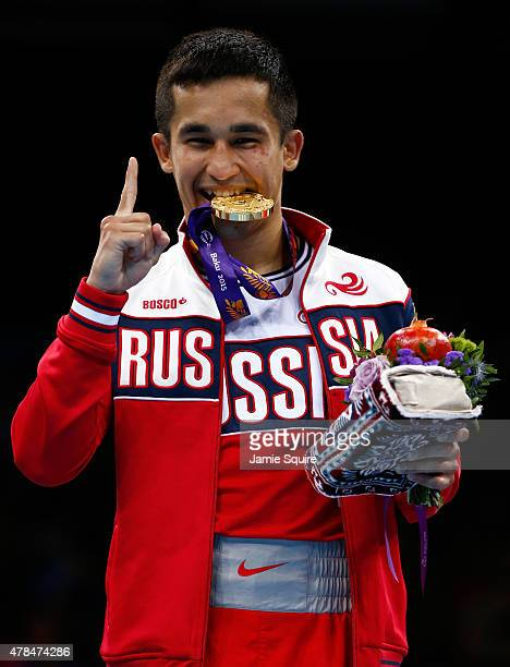 Gold medalist Bakhtovar Nazirov of Russia stands on the podium during the medal ceremony for the Men's Bantamweight 56kg final during day thirteen of...