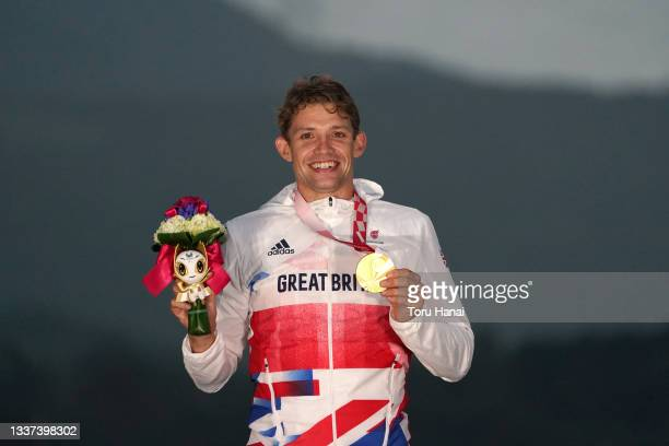 Gold medalist Benjamin Watson of Team Great Britain celebrates on the podium during the medal ceremony for the Cycling Road Men's C3 Time Trial on...