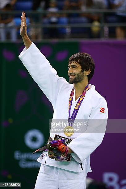 Gold medalist Beslan Mudranov of Russia poses on the medal podium following the Men's Judo 60kg Finals during day thirteen of the Baku 2015 European...