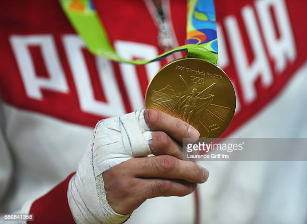 Gold medalist Beslan Mudranov of Russia shows his medal after the Men's -60 kg Judo competition on Day 1 of the Rio 2016 Olympic Games at Carioca...