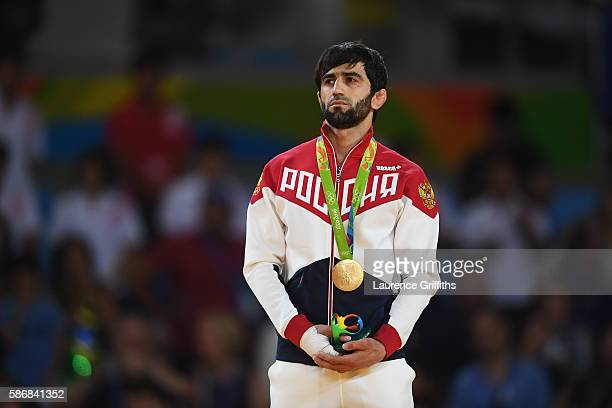 Gold medalist Beslan Mudranov of Russia stands on the podium after the Men's -60 kg Judo competition on Day 1 of the Rio 2016 Olympic Games at...